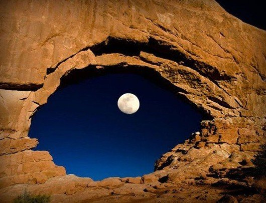 the moon through north window arches